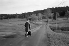 Middle of the Road  (Fuji Acros) (Harald Philipp) Tags: woman stroller babybuggy selfdeveloped homedeveloped xtol rangefinder rollei35 sonnar 40mm primelens haraldphilipp outdoors rural fujifilm acros iso100 iso60 film grain analog filmphotography 35mm 135 monochrome bw blackandwhite analogue europe european switzerland schweiz zug ägeri ägerital aegeri road country lane