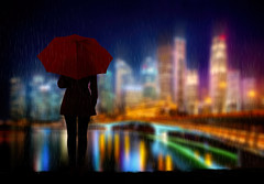 City Rains (chiaralily) Tags: chiaralily photoshop manipulation rain city cityscape woman red umbrella night buildings river blur landscape aoi awardtree