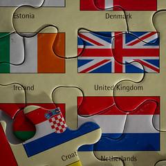 The Odd One (kurjuz) Tags: european macromondays national theoddone flags