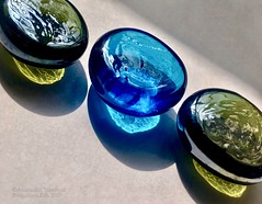The world says fit in ..but.. (Anuradha Nautiyal) Tags: macromondays theoddone glasspebbles pebbles reflection light backlight phonephotography shotoniphone iphonex bangalore bengaluru karnataka india
