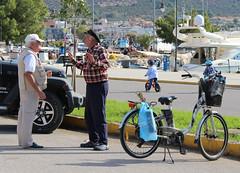Τα νέα της μέρας (Argyro Poursanidou) Tags: people talking life street man