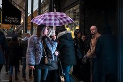 Well hello... (Silver Machine) Tags: london mayfair streetphotography street candid people groupofpeople shopping rain umbrella man woman looking thelook shopwindow windowlight fujifilm fujifilmxt10 fujinonxf35mmf2rwr