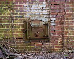 Light Me Up Baby (Dysfunctional Photographer) Tags: furnace boiler door metal iron brick mold vines abandoned rust pinebluff arkansas 2020 usa nikon z7 nef raw captureone