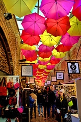 Brollies (Croydon Clicker) Tags: umbrellas brollies market shops people street signs merchandise camden london nikond700 nikkoraf28105mmd