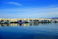 boats in blue (majka44) Tags: boat cyprus sea view travel light sky reflection stone wall landscape memory blue atmosphere nice mood cloud mountain marina port pier serene clear calm bright europe