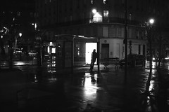 Under the shelter (pascalcolin1) Tags: paris13 homme man abri shelter nuit night lumière light pluie rain reflets reflection photoderue streetview urbanarte noiretblanc blackandwhite photopascalcolin 50mm canon50mm canon busshelter abribus