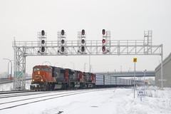 CN 324 (Michael Berry Railfan) Tags: cn train canadiannational freighttrain cn5700 cn324 winter snow montreal dash944cw dash9 sd70m2 sd75i cn8007 turcotwest turcotouest montrealsub bcol4647