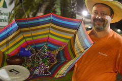 A bead catching solution (radargeek) Tags: lakecharles la louisiana merchantsparade 2019 march night beard cowboy hat beads mardigras umbrella smile frisbee