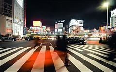 Crossing (David Panevin) Tags: 歌舞伎町 kabukicho 新宿区 shinjuku 東京 tokyo japan olympus omd em1 lumixgvario714mmf40asph street path buildings shops crossing people blur signs posters evening night lights urbanfragments davidpanevin