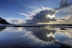 A Dark Eye (pauldunn52) Tags: beach reflections clouds traeth mawr glamorgan heritage coast wales