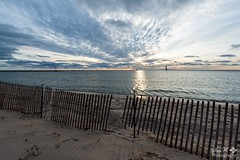 Sunburst Sunset (SueFi Photography) Tags: lakemichigan greatlakes sunset upnorth beach fences clouds