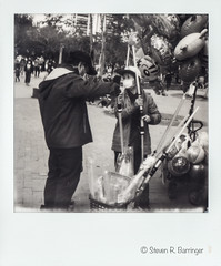 closing the deal at the park (steve: they can't all be zingers!!! (primus)) Tags: polaroidsx70alpha1 sx70polaroidoriginalbw film sx70 sx70alpha monochrome bw blackwhite filmcamera