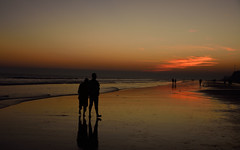 Holding together in sunset of life. (draskd) Tags: sunset together love life seabeach sunsetlight dusk tajpur digha mandarmani landscape sea seashore silhouettes couple dayend companion loved one journey