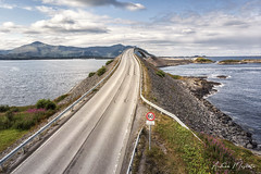 Storseisundet Bridge - Atlantic Ocean Road (Norway) (Andrea Moscato) Tags: andreamoscato norvegia norge bokmål nynorsk north europe view vivid vista day light luce shadow ombre blue white red yellow water sea art artist nature natura natural naturale fiordo fiord mare landscape trail history historic panorama tourist attraction rock stones dji mavic air quadcopter drone overlook island green street road grass bridge ponte isola deep ocean oceano car clouds sky nuvole cielo atlantic waves strada perspective sign