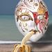 Still life with a Venetian mask, a banana and alarm clocks