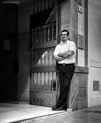 Guard (Bart van Hofwegen) Tags: man guard door stand wait standing waiting street streetphotography streetportrait people urban urbanphotography urbanlife blackandwhite monochrome