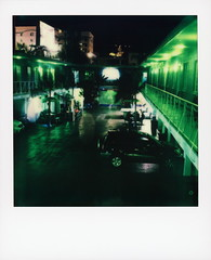 Banana Bungalow Nights 1 (tobysx70) Tags: polaroid originals color sx70 instant film sx70sonar sonar banana bungalow nights vibe hotel movie town motel hollywood blvd boulevard los angeles la california ca courtyard night nocturnal illuminated balcony car automobile youth hostel palm tree silhouette vanishing point green toby hancock photography