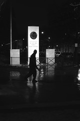 In front of the illuminated column (pascalcolin1) Tags: paris13 homme ma nuit night lumière light reflets reflection pluie rain colonne column photoderue streetview urbanarte noiretblanc blackandwhite photopascalcolin 50mm canon50mm canon