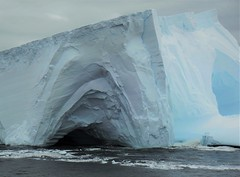 The iceberg with two caves. (Ruby 2417) Tags: landscape scenery ice iceberg cave nature natural ocean sea southern antarctica antarctic caves snow frozen summer peninsula cruise ship boat water