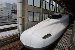 An earlier Shinkansen arrival at Hiroshima- a N700 series bullet train (shankar s.) Tags: eastasia japan landoftherisingsun nippon nihon hiroshima shinosakastation japanpublictransport shinkansen bullettrain highspeedintercityexpresstrain electricrailcartrain electricmultipleunit tokaidosanyoshinkansen japanrailwaysgroup jr nozomirapidexpress n700series railwayplatform railroadplatform barriers shinkansentraincar drivingtrailer businessend