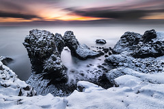 Arnarstapi - another world (Pete Rowbottom, Wigan, UK) Tags: arnastarpi anarstapi stapi sunrise seaarch sea ocean coast island iceland nisifilters fotopro snow ice winter dramaticsky longexposurelandscape longexposure verylongexposure snaefellsness europe travel peterowbottom seascapes seascape sunlight sun light movement surreal rocks coastal geology basalt cloudmovement cloudscape flickr photography landscapephotography slowshutterspeed slowshutter nikond850 naturalarch seastack art nature beauty