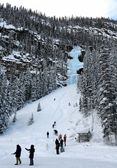 Hiking  to the Waterfall (Anthony Mark Images) Tags: people climbing hiking trail snowcoveredtrees snow ice icicles frozenwaterfall footprints frozenlake mountain lakelouise alberta canada cliffs clouds banffnationalpark beautifuil pretty winter winterscenery iceclimbers