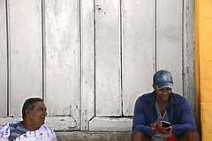 Good News (emerge13) Tags: trinidadsanctispirituscuba trinidadcuba cuba people humans candid architecturedetails colonial textures colorful colors expressions portraits portrait candidportrait doors saariysqualitypictures
