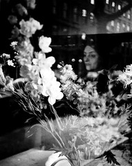through flowers (Gabriella Ollandini) Tags: woman lady flowers framed 35mm analog analogue analogica istillshootfilm kodak portrait streetphotography candid mood atmosphere blooms filmisnotdead filmphotography filmcamera dreamy lomo lca softfocus feminine romance love monochrome bw bwfp blackandwhite nature