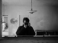Grandma's house (Zack Huggins) Tags: olympusomdem5markii olympusmzuiko17mmf18 vscofilm pack06 bivinstx easttexas grandmashouse thanksgiving homefortheholidays homestead behindthepinecurtain empty abandoned mirror selfie selfportrait bw mono monochrome rnifilms portrait bokeh dof microfourthirds reflection renovation livingroom house home memories paint light lightfixture decay entropy