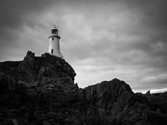 The Lighthouse (Feldore) Tags: lighthouse corbiere jersey channel islands olympus em1 1240mm landscape mono feldore mchugh moody rocks cliff stark