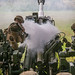 U.S. Marines conduct a reload of an M777 Howitzer during a fire mission on Schofield Barracks