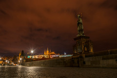 Statue on Charles Bridge (Karluv Most) and St. Vita Cathedral at night, Prague (wounderful0) Tags: bridge view charlesbridge karluvmost night evening prague czech popular famous dark romantic empty tourism tourist travel destination holiday architecture building street city old urban town europe twilight stone historic background landmark gothic medieval culture illuminated history ancient czechrepublic capital tower light sculptures streetlights streetlamps scenic statues midnight sky clouds cathedral