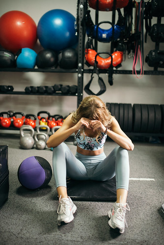 Portrait of an attractive woman resting after the workout in the gym