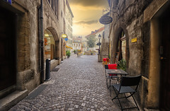 Old Town path in Geneva, Switzerland (` Toshio ') Tags: toshio geneva switzerland swiss europe oldtown path cafe restaurant sunset cobblestone european fujixt2 fuji xt2 table chairs stairs shops store