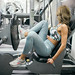 Attractive woman exercising legs in the gym
