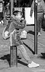 Snack Attack... (Patricia Wilden) Tags: cambridge eating monochrome street blackandwhite moon boy snack eos70d