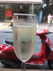 Don't Drink and Ride (raaen99) Tags: cafféetorta caféetorta caffeetorta cafeetorta cafe café restaurant vespa red redvespa glass champagneglass champagneflute prosecco bubbles alcohol transport melbourne victoria australia window bar littlecollinsstreet littlecollinsst royalarcade arcade food drink alcoholicbeverage beverage street streetphotography shop shops shopping city cityscape road cherryred vermilion fireenginered brightred scooter