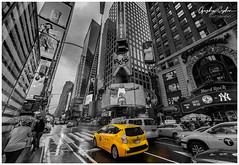 Yello Mellow Manhattan (Oguzhan Amsterdam) Tags: new york city nyc manhattan yellow cab taxi wideangle street streets downtown usa skyscrapers black white except one color monochrome bw nikond800 nikkor1424 oguzhan ceyhan photography urban cityscape citycentre travel
