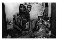 women in the kitchen (handheld-films) Tags: india rural rajasthan home interior kitchen women cooking pots pans lowlight domesticlife seated divali indian traditional villages people portrait portraiture documentary travel blackandwhite monochrome mother daughter family families togetherness sharing