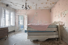 Sleepy Hollow Manor (Jonnie Lynn Lace) Tags: abandoned abandonedamerica america american usa unitedstates interior house home mansion manor old convalescent bed bedroom chandelier classic history time memories decay derelict detail peelingpaint pink yellow blue white pastel soft light day windows door nikkor nikon d750 24mm digital flickr jonnielace morning texture details exploration explore explorer urbex lost lostplace room