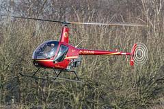 G-ORMB - 1990 build Robinson R22 Beta, wintry background on the approach to Barton (egcc) Tags: 1607 barton beta cityairport egcb gormb heliair heliairscotland heliaircom helicopter lightroom manchester r22 robinson