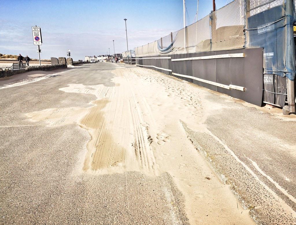 Sand on road