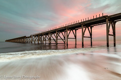 THE EYES   (Explored) (lynneberry57) Tags: hartlepool steetely beacch sunset pier water sea tide waves incoming movement beach sand buried eyes sky pink clouds structure coast seascape landscape canon 70d leefilters nature light