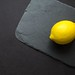Photo of yellow lemon on gray surface - Credit to https://homegets.com/