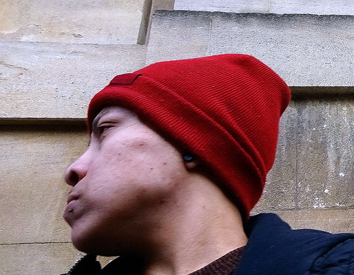 Man in a red wooly hat