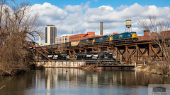 CSX N89505 Shiplock 4566 (HeritageNY) Tags: csx ns emd shiplock canal water skyline richmond train bridge viaduct coal
