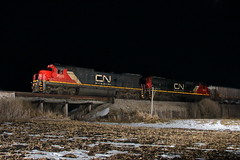 CN 2022 west in Genoa, Illinois on February 7, 2020. (soo6000) Tags: ge c408 standardcab 2022 cn2022 woodentrestle freeportsub cn m33791 manifest train freight railroad farmland rural nighttime genoa illinois