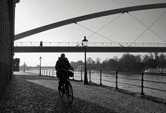 Along the Meuse (peer.heesterbeek) Tags: meuse water river bicyclist walking bridge shadow sunlight blackwhite monochrome maastricht netherlands