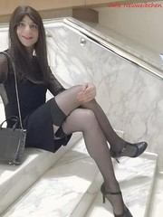 I can't imagine a life without Saturday evenings (julie.neuweibchen) Tags: crossdresser semitransparent littleblackdress seamed stockings highheels sitting