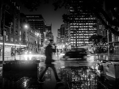 Auckland Dark Rain (SnapsByBarrie) Tags: auckland olympus rain em1 monochrome blackandwhite bw blackwhite weather sealed night lights city reflections wet quaystreet car headlights office